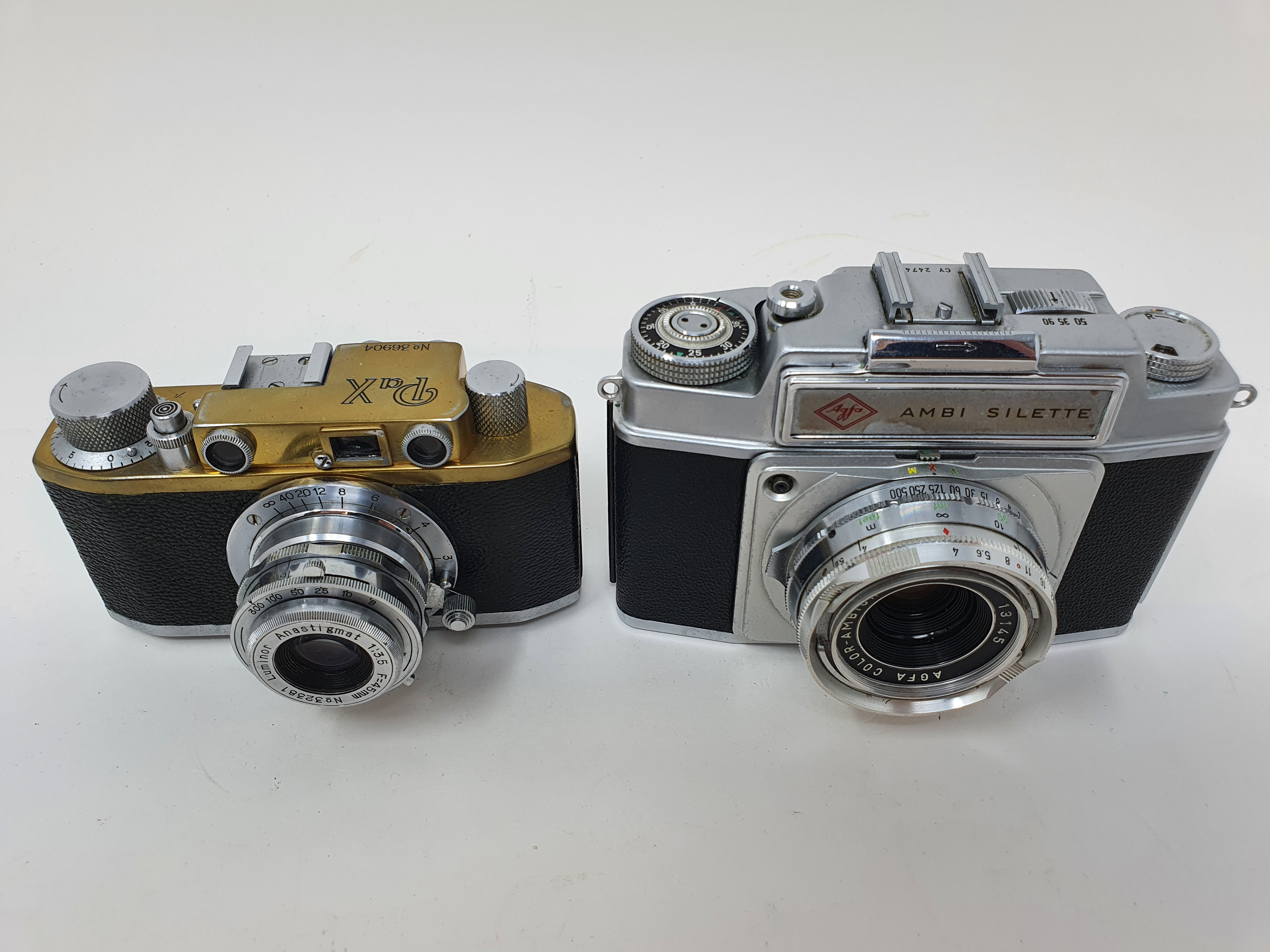 A PaX camera, serial number 36904, and an Agfa Ambi Silette camera (2) Provenance: Part of a vast - Image 2 of 4
