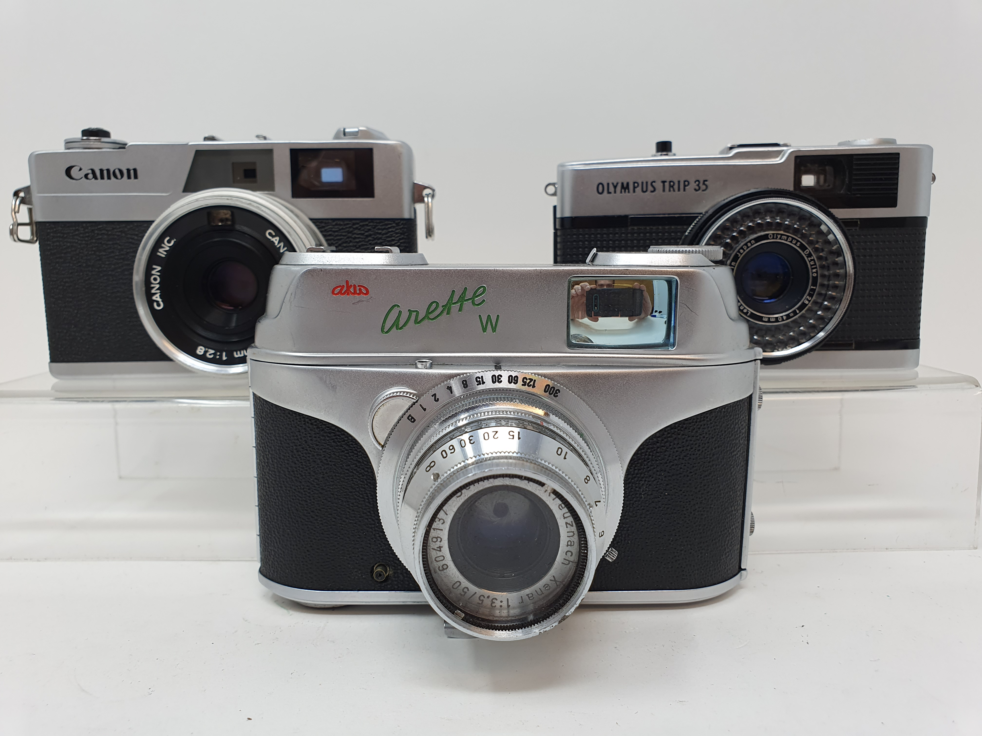 An Arette W camera, an Olympus Trip 35 camera and a Canon Canonet 28 camera (3) Provenance: Part
