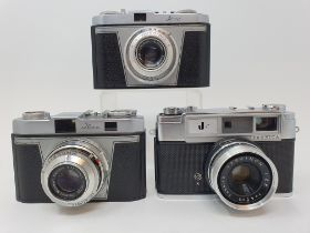 A Yashica camera, an Iloca Rapid-B camera and an Iloca Rapid camera, in outer leather case