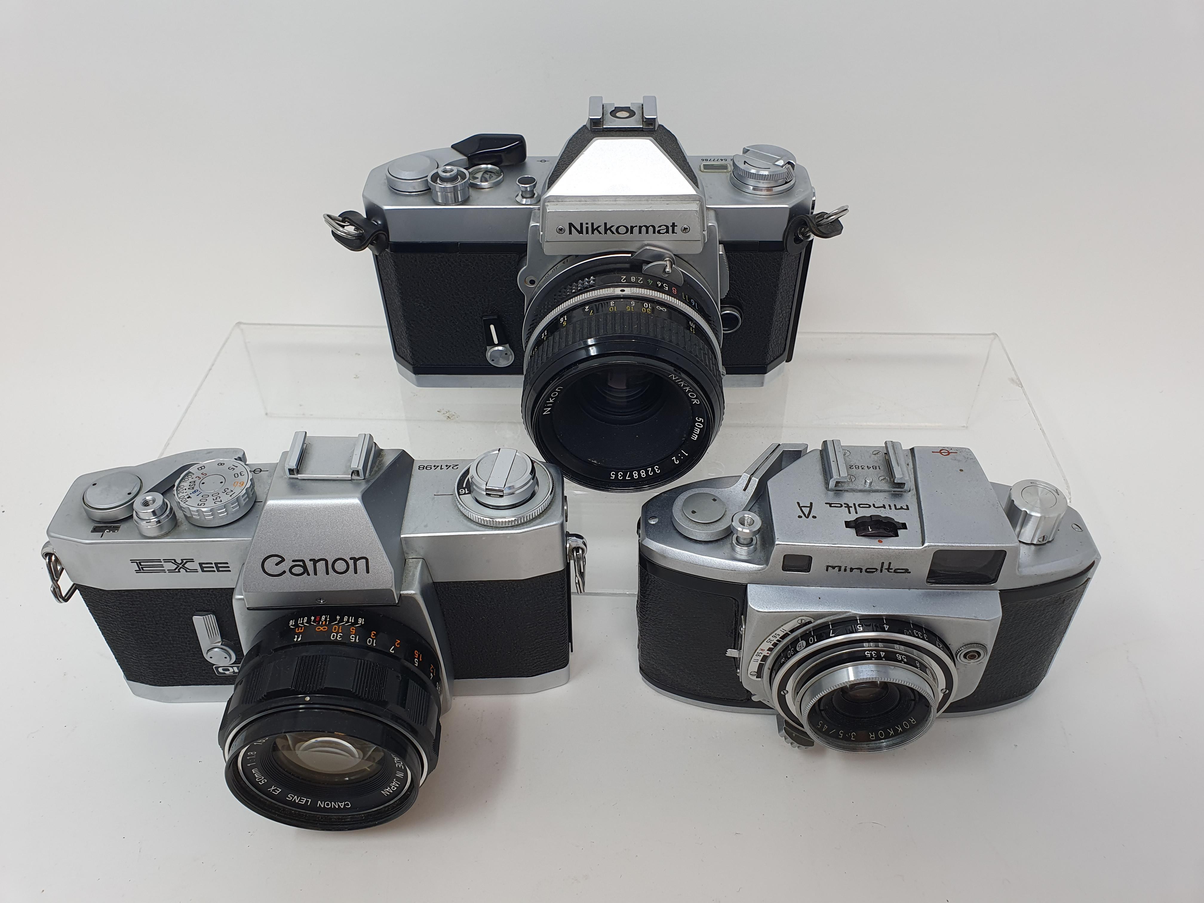 A Nikkormat Nikon, a Minolta A camera and a Canon EX EE camera (3) Provenance: Part of a vast single - Image 2 of 2