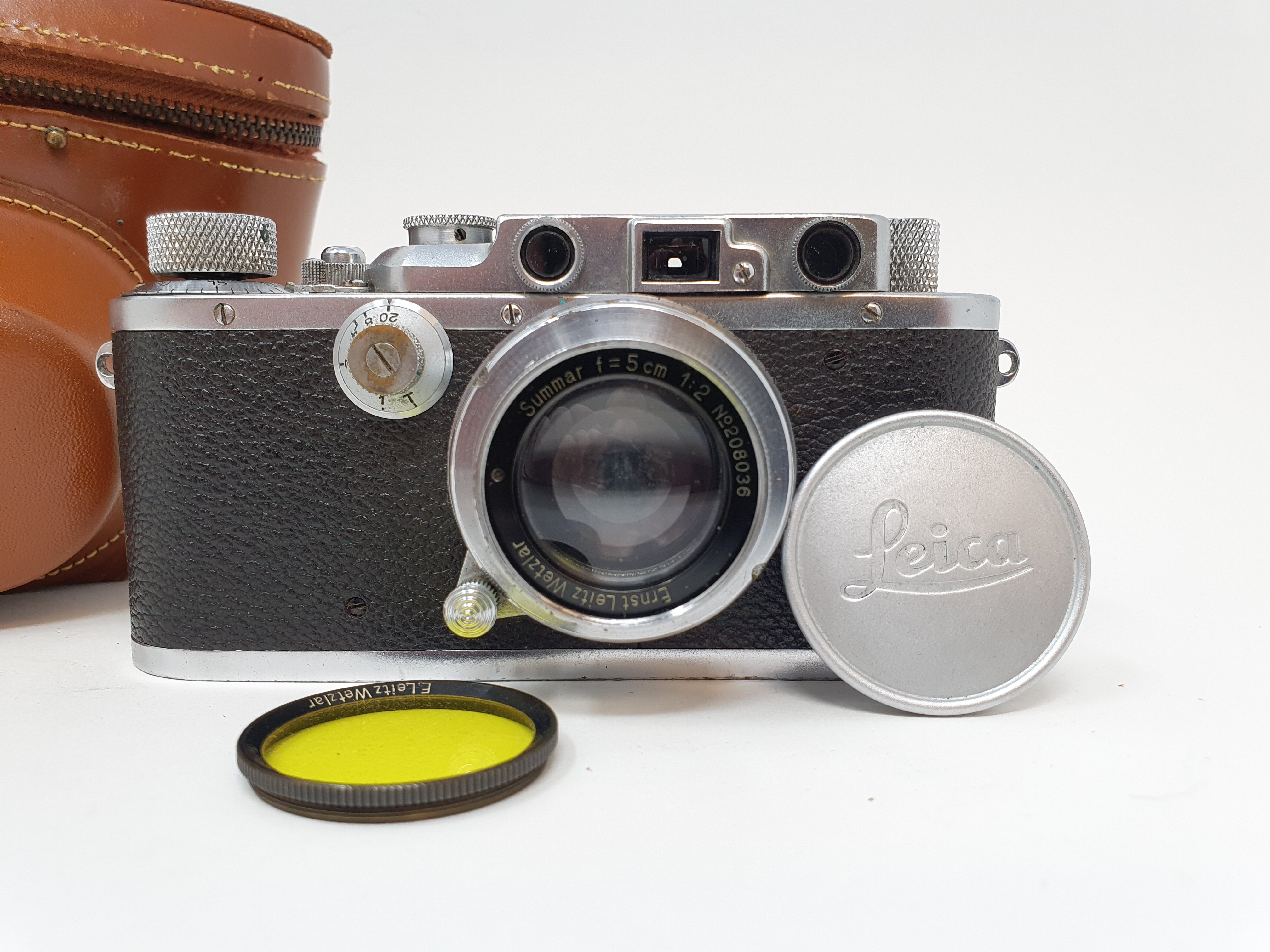 A Leica camera, serial number 120761, with leather outer case Provenance: Part of a vast single
