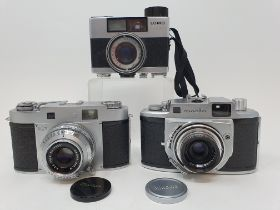 A Mamiya-35 camera, with outer leather case, a Lomo 35 BC camera, and a Minolta A camera, with outer