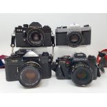 A Pentax Program A camera, Pentax SP 1000 camera, a Praktica EE 2, and a Canon EF camera (4)