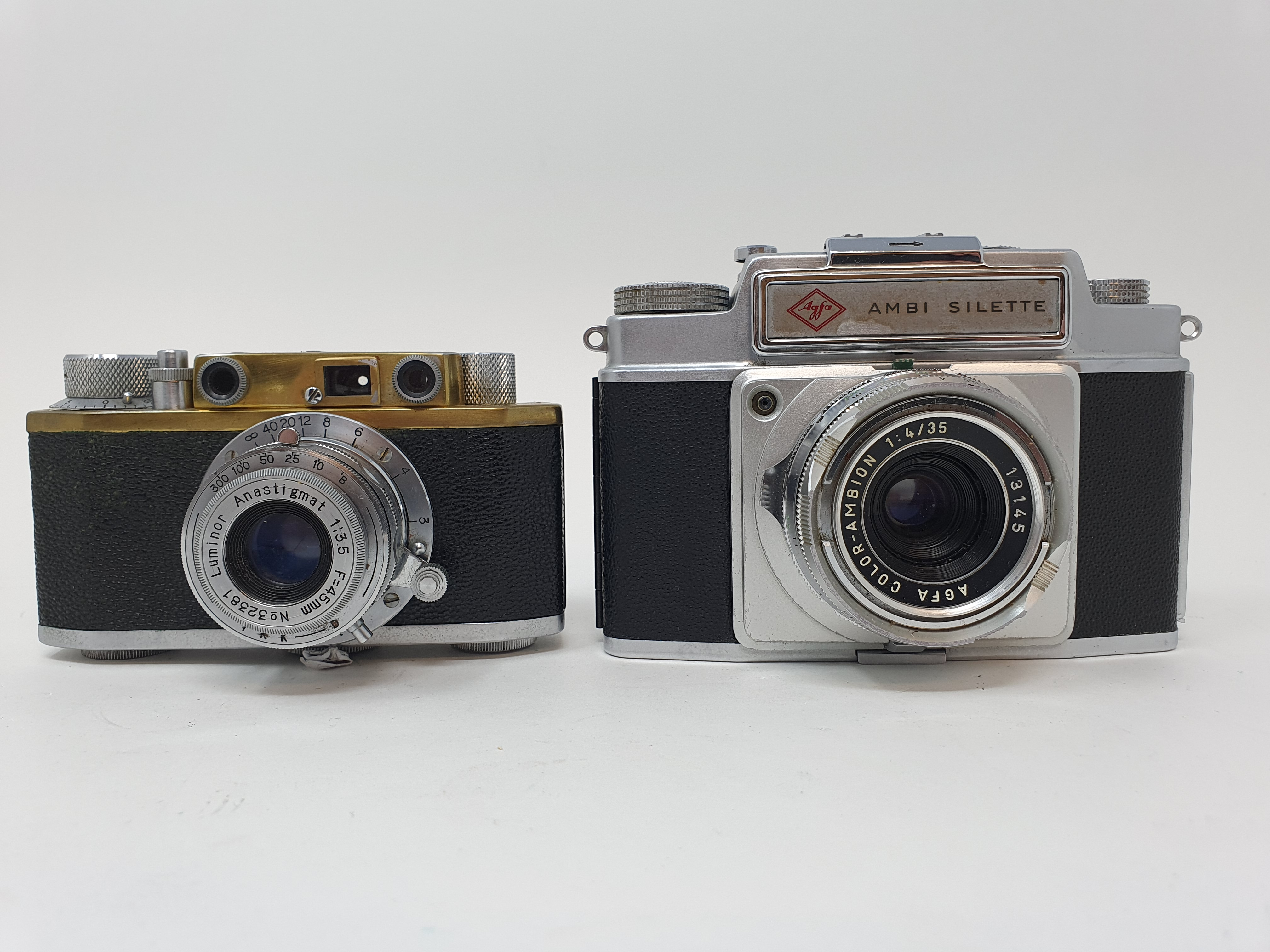 A PaX camera, serial number 36904, and an Agfa Ambi Silette camera (2) Provenance: Part of a vast