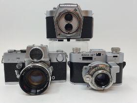 A Petri Flex 7 camera, a Kodak 35 camera and a Agfa Flexilette (3) Provenance: Part of a vast single