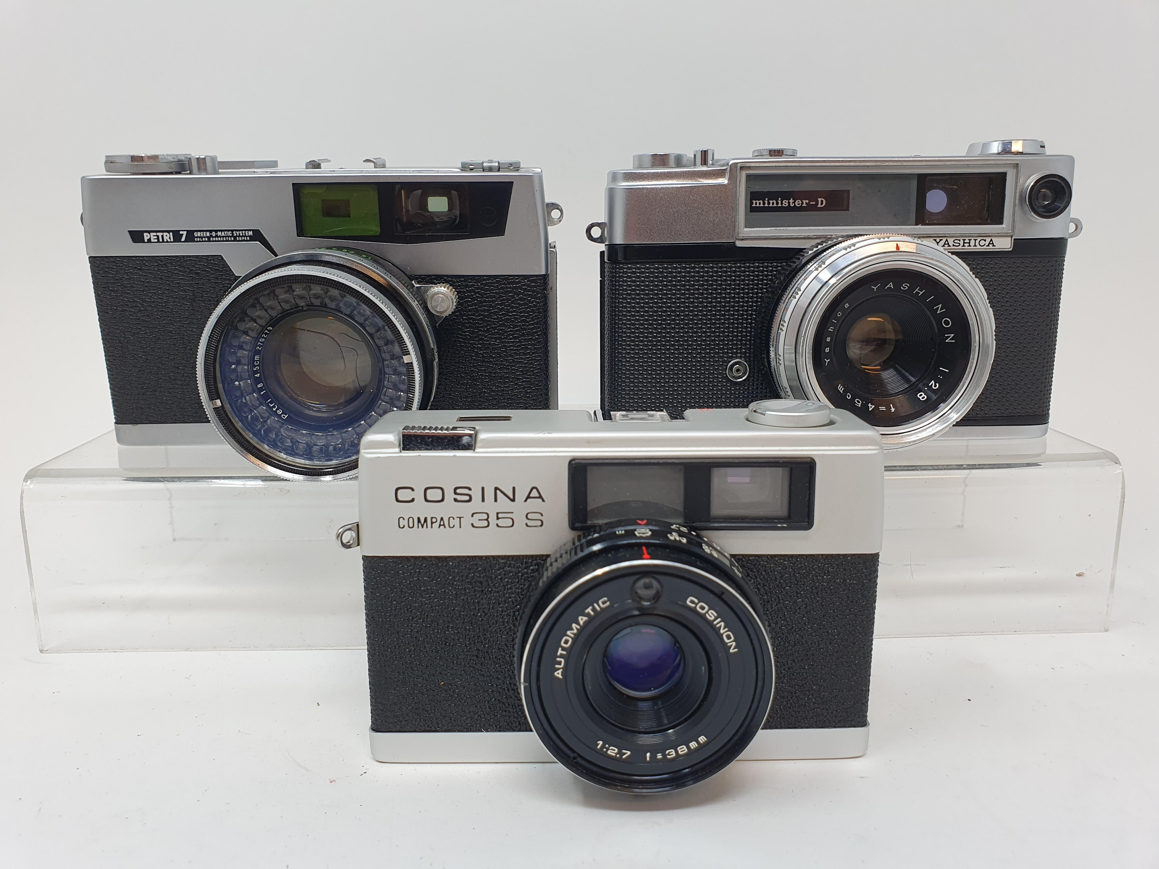A Cosina compact 35S camera, a Yashica camera, serial number T-737513, and a Pretri 7 camera (3)