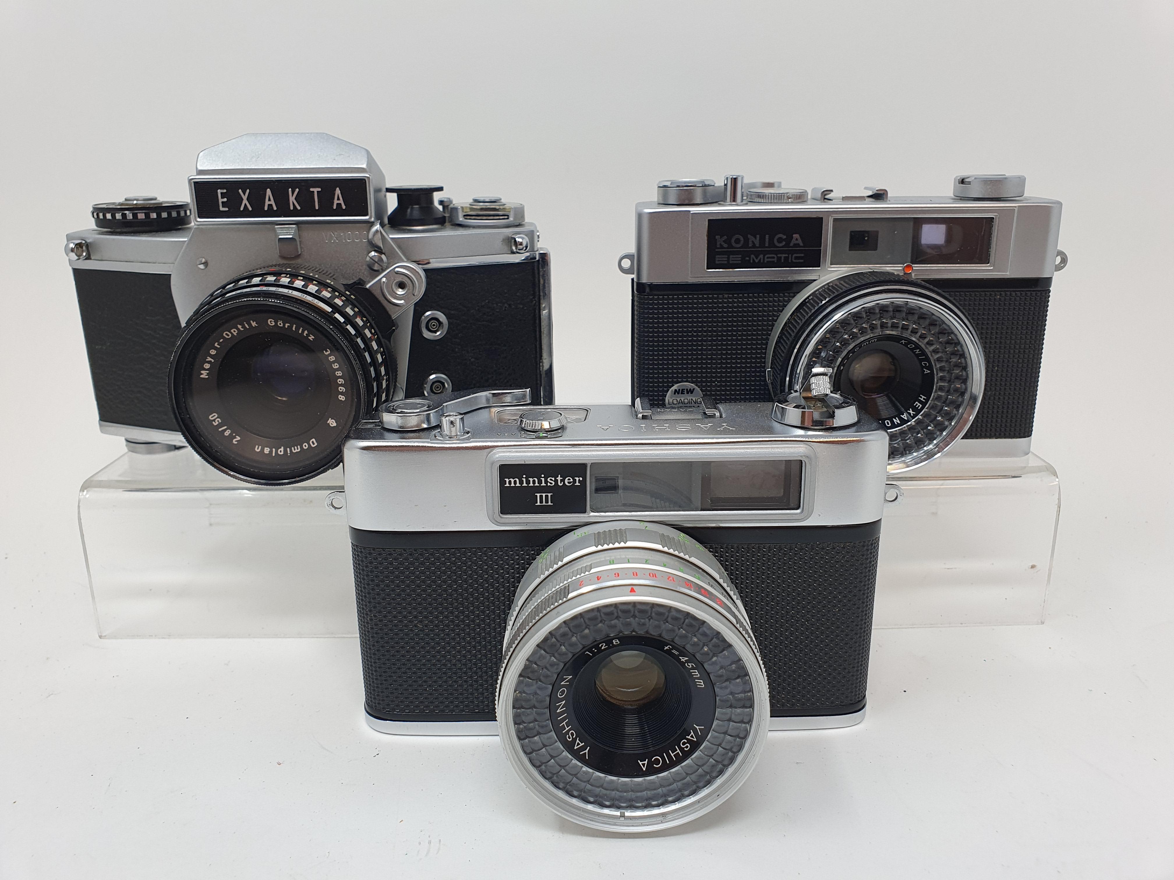An Exakta VX 1000 camera, a Konica EE-Matic camera and a Yashica Minster III camera (3)