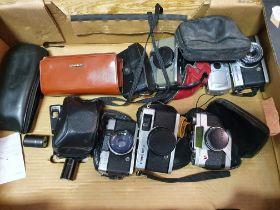 An Olympus Trip 35 camera, an Olympus I-10 camera, an Olympus-Pen camera, an Minox 35 GT camera,