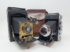 A Zeiss Ikon Ikonta folding camera, in leather outer case, and a Kodak model H folding camera, in