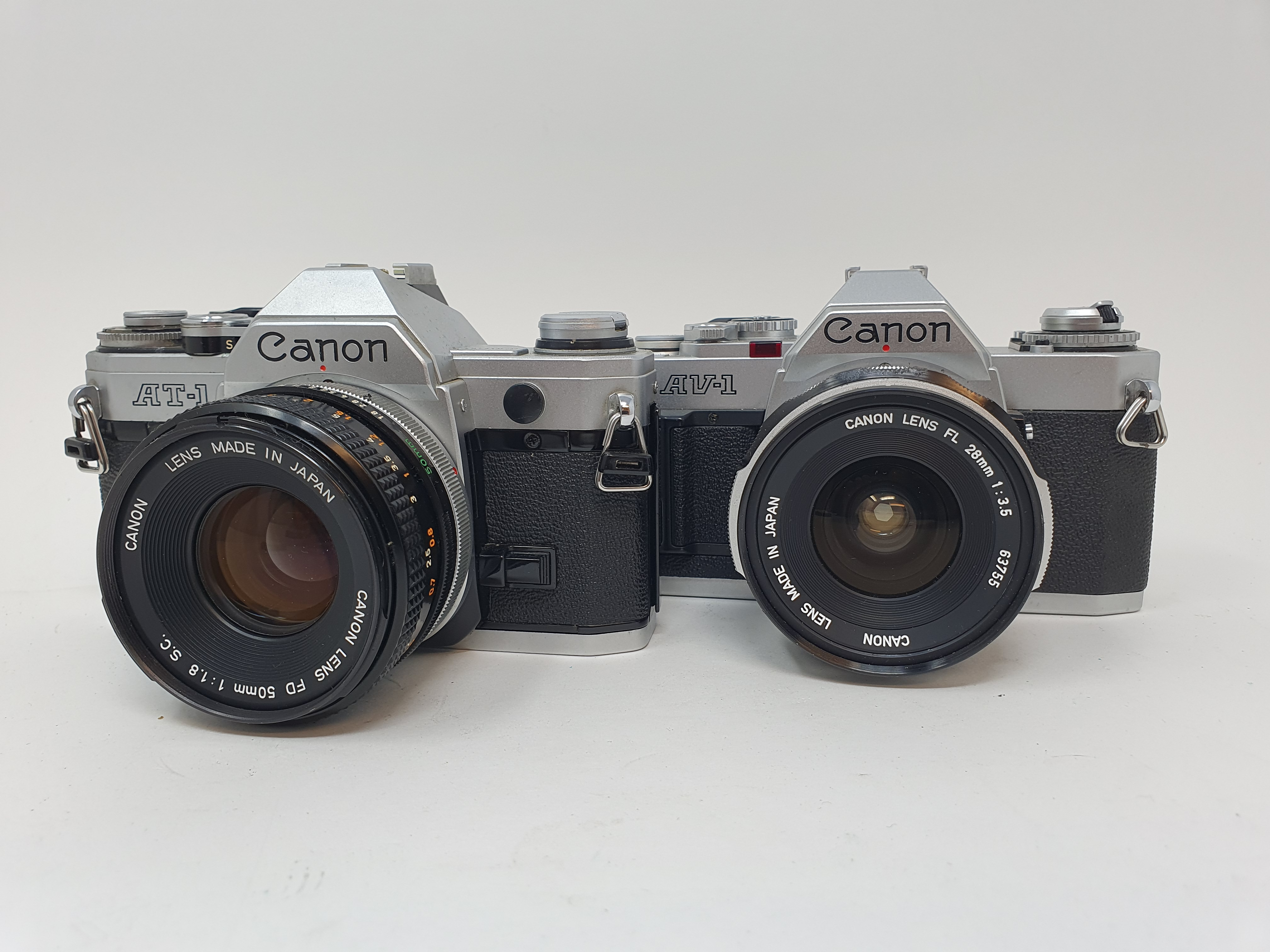 A Canon AT-1 camera and a Canon AV-1 camera (2) Provenance: Part of a vast single owner collection