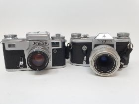 A Pentacon FM camera, with original instructions and a Russian camera (2) Provenance: Part of a vast
