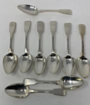 Nine silver fiddle pattern dessert spoons, initialed, various dates and makers, 12.7 ozt