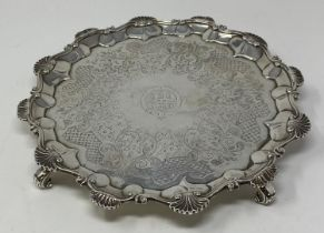 A late 18th century silver salver, later initialed within a garter, with a pie-crust edge, and