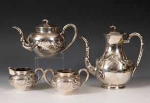 A Chinese silver coloured metal four piece tea set, with bamboo finials, the bodies embossed in high