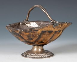 An unusual basket, fashioned from a tortoise carapace, with silver coloured metal mounts, 10 cm high
