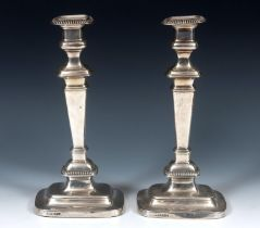 A pair of early 18th century style silver candlesticks, of rectangular form, Sheffield 1917, 31 cm