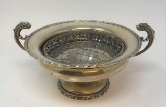 A silver pedestal bowl, inscribed, with dragon handles, Chester 1915, 16.5 ozt, 26 cm wide