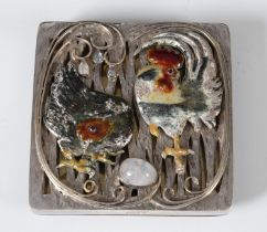 An unusual silver and enamel desk weight, decorated a cockerel, chicken and an egg, 8 cm wide
