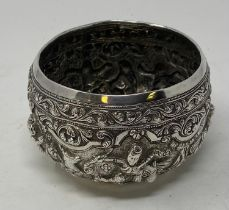 A Burmese silver coloured metal bowl, embossed figures and foliage, 11 cm diameter 7.0 ozt