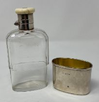 A glass flask, with silver and ivory mounts, initialed, with detachable cup, London 1930