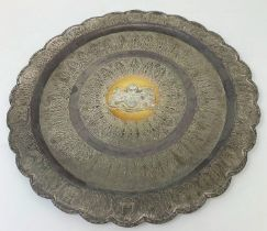 A Malaysian silver coloured metal tray, the centre applied an armorial inscribed with a presentation