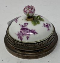 A French porcelain and silver coloured metal mounted bell push, with floral decoration, the flower