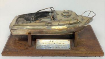 A silver plated model of a motor launch, slight loss, 24 cm wide, on a stand with a plaque J G J HMS