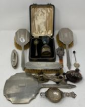 A Mr Punch silver and agate teether, Birmingham 1912, some damage, 12.5 cm, a silver Christening