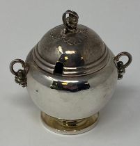 A Georg Jensen silver mustard pot and cover, 724, 7 cm high no 724, good condition