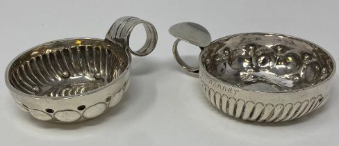 A French silver coloured metal wine taster, inscribed in J Barret, 11.5 cm, and another similar,