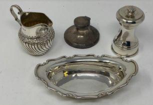 A late Victorian silver cream jug, Birmingham 1890, a small silver dish, 4.1 ozt, a silver capstan