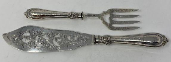 A pair of Victorian silver fish servers, handles loaded, Birmingham 1855
