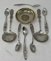A Sterling silver bowl, inscribed and inset a USA dollar coin, 1890, a pair of silver serving