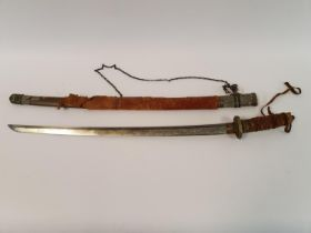 A Japanese Katana, with a cord bound fishskin grip, in a painted metal scabbard Provenance brought