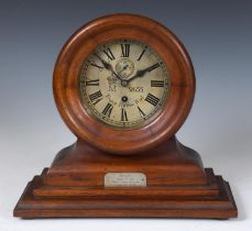 An Imperial German Navy bulkhead type clock, the 15 cm diameter silvered dial signed Franz Happe