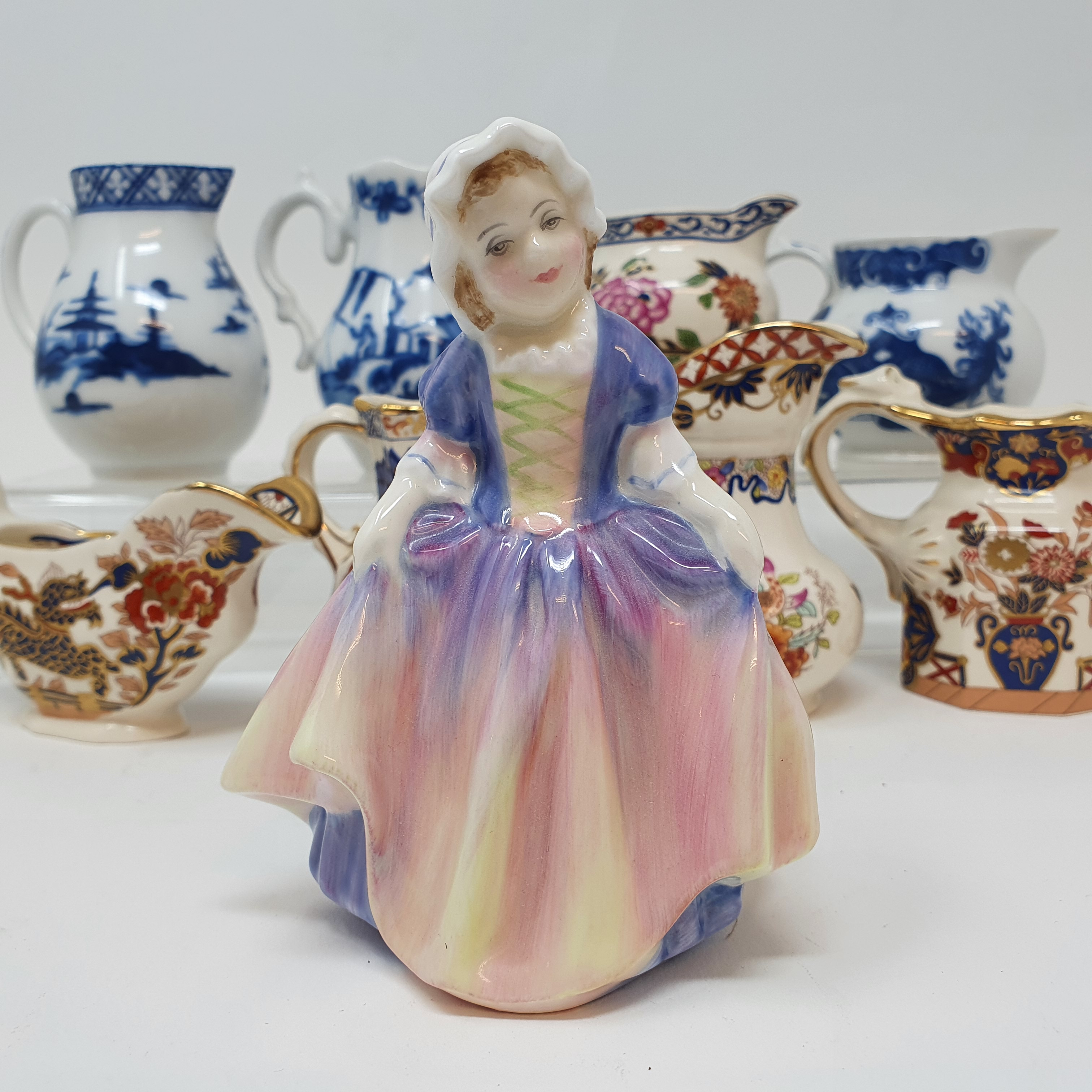 A Royal Doulton figure Dinky Do, HN1678, seven modern Royal Worcester blue and white cream jugs