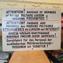 A sign, 'Attention! Passage of Members of foreign Military Liaison Missions Prohibited!', also