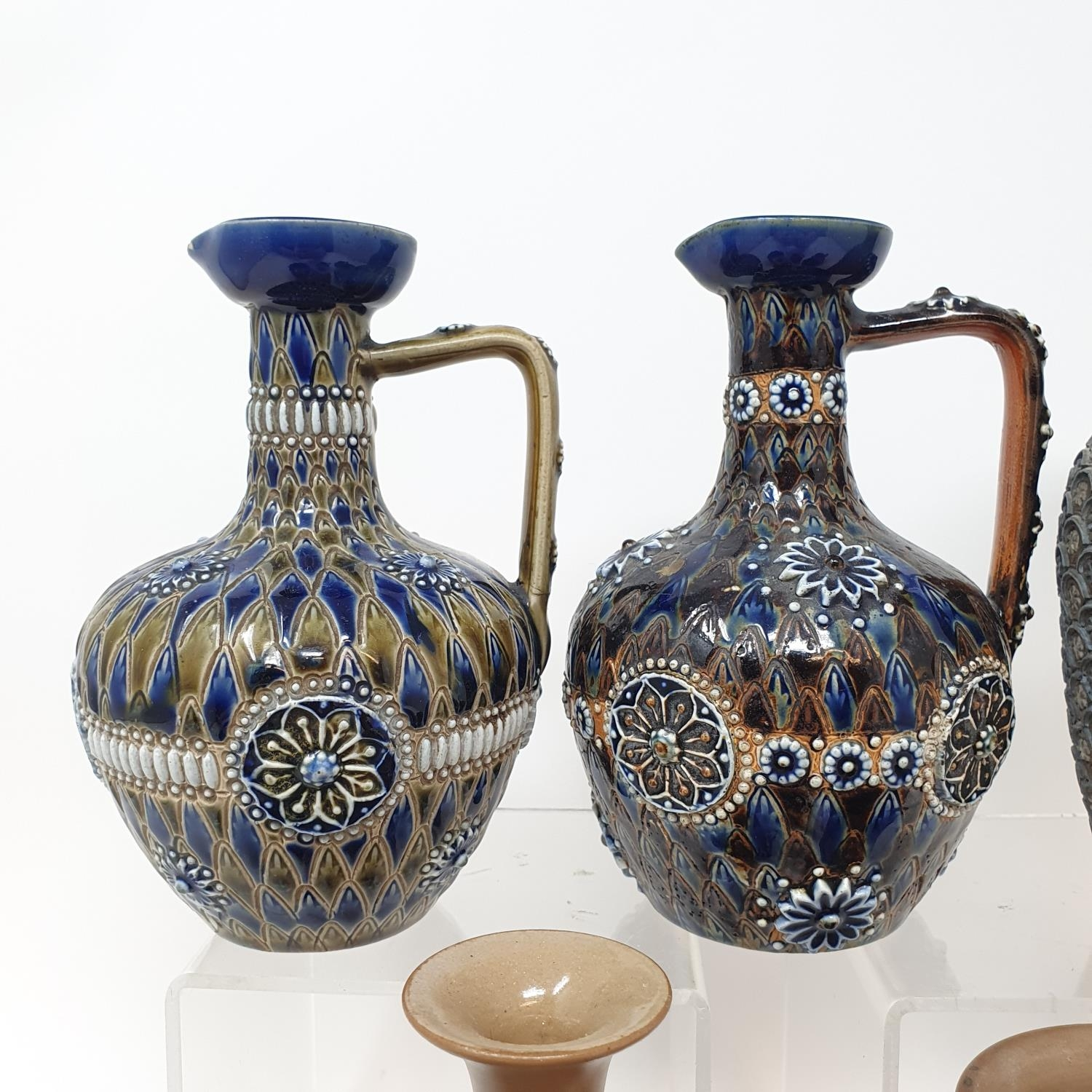 A pair of Doulton Lambeth jugs, 15 cm high, and six other items of Doulton (8)