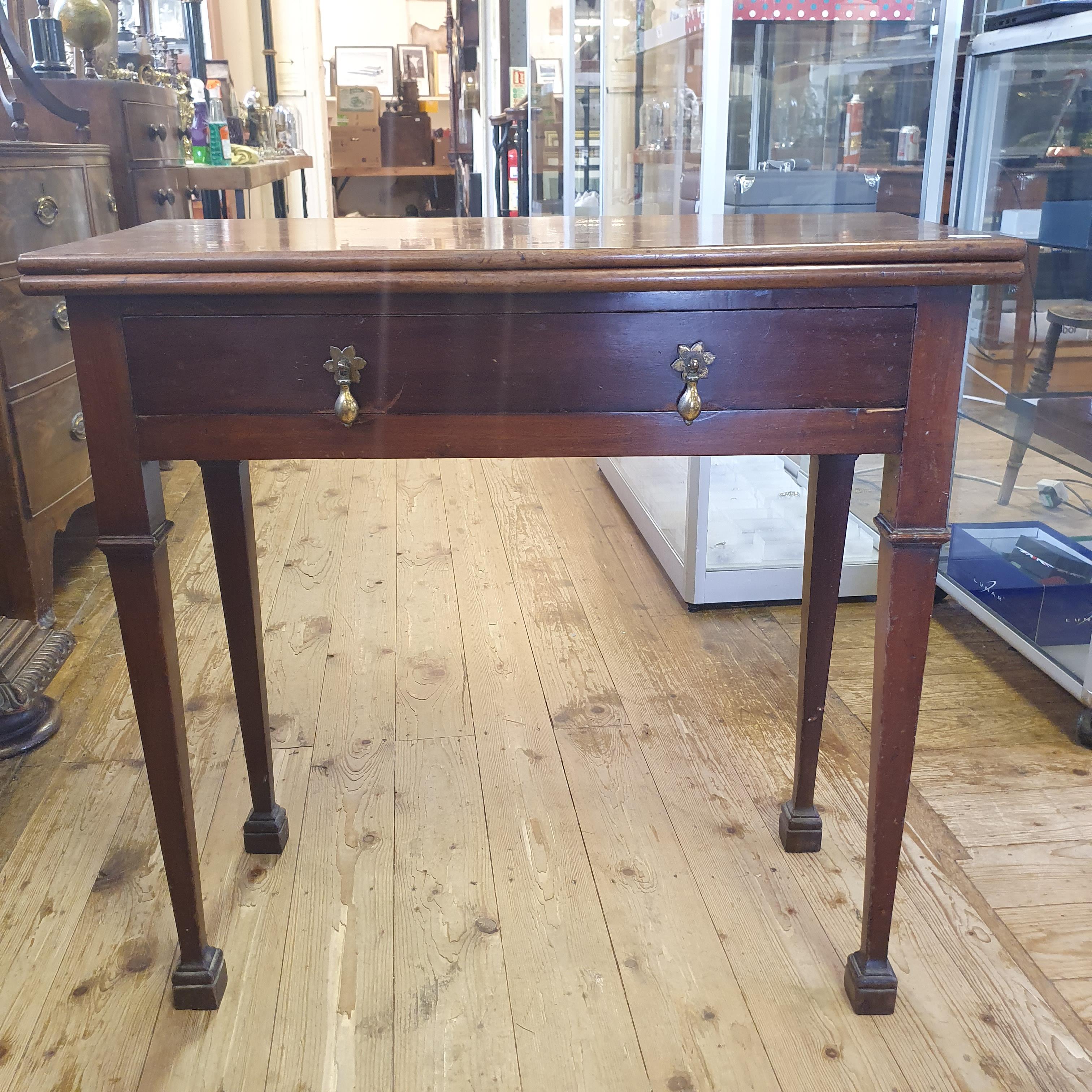 A 19th century mahogany tea table, 76 cm wide