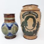 A Doulton Lambeth commemorative jug, General Gordon 20 cm high, and a Doulton commemorative jug,