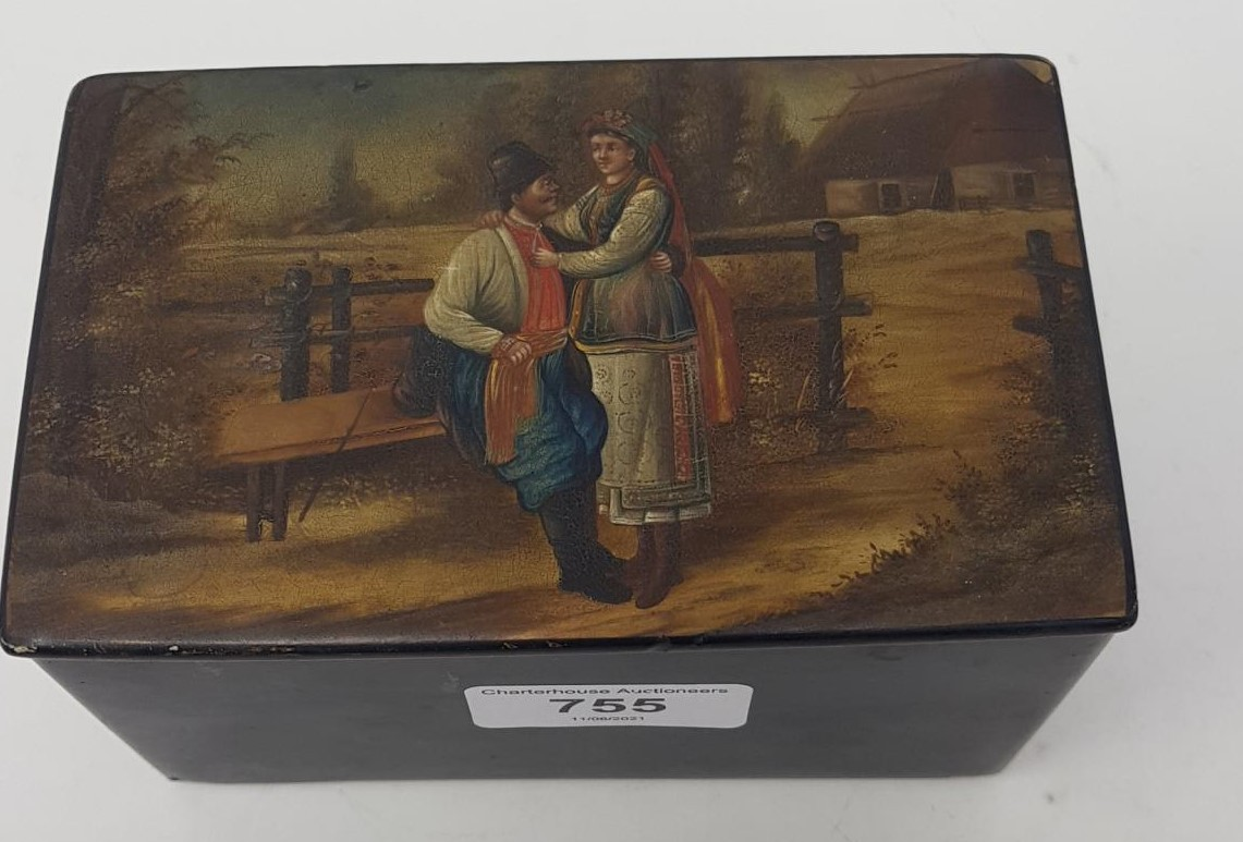 A Russian tea caddy, decorated an amorous couple by a fence, 14 cm wide