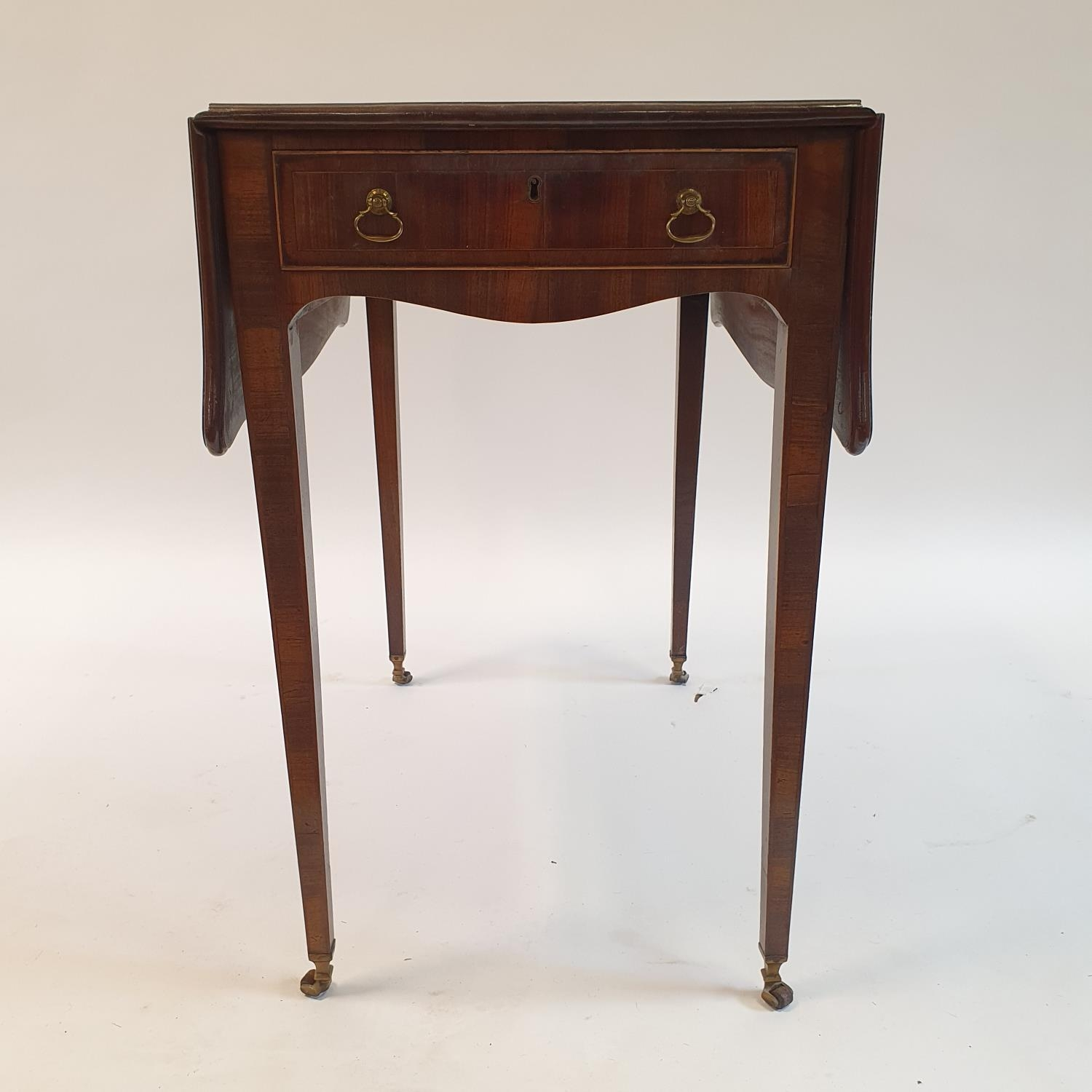 A George III mahogany butterfly top Pembroke table, of small proportions, crossbanded in rosewood,