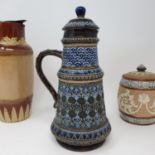 A Doulton Lambeth jug and cover, decorated foliate forms, 26 cm high, a tobacco jar, 16 cm high