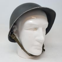 An American military helmet, on a head stand