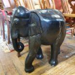 A carved ebony elephant, 56 cm high