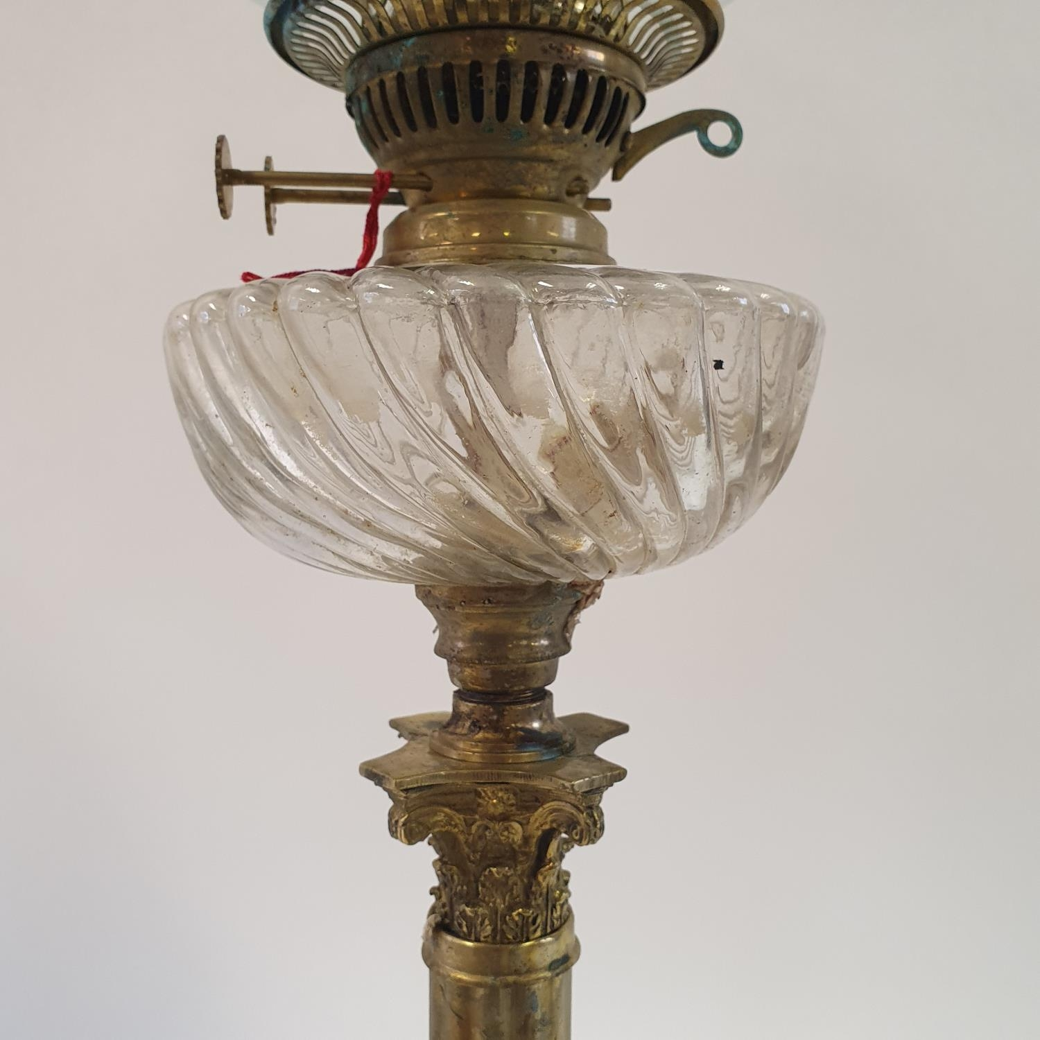An oil lamp, with an acid etched glass shade, a clear glass well, on a brass base in the form of a - Image 2 of 3