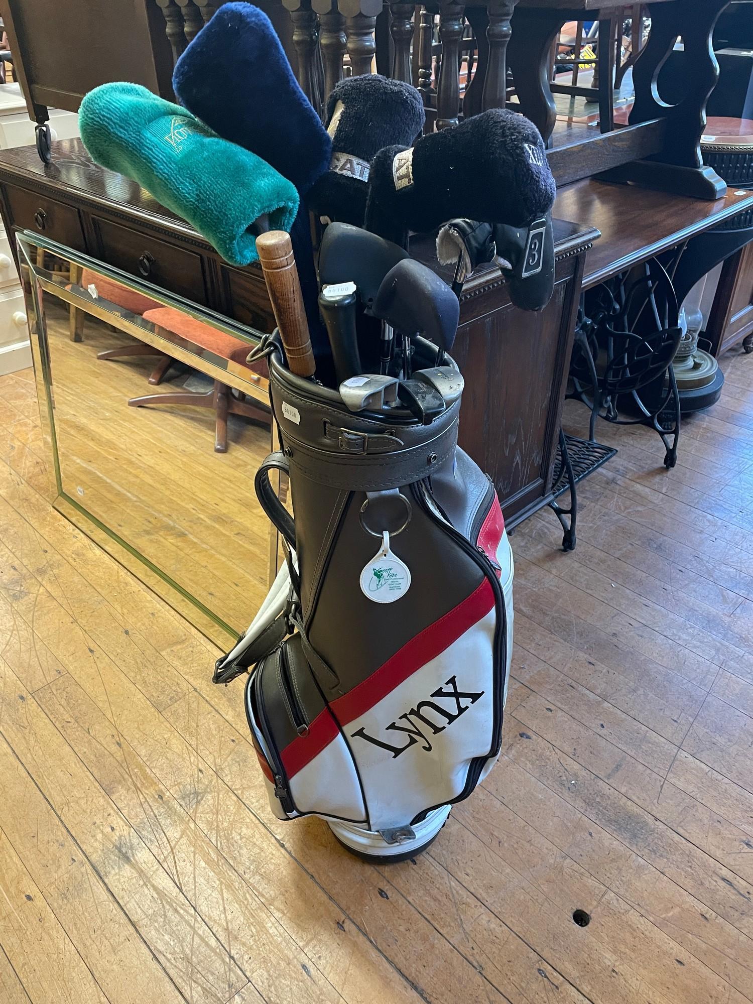 A Lynx Black Cat driver, various golf clubs and a bag (qty)