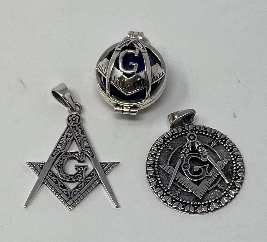 A silver masonic fob, and two others (3) This is a modern copy