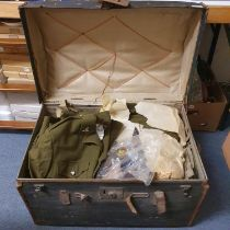Assorted Queen Elizabeth II military uniforms, including a No II dress, in a dome top travelling