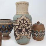 A Doulton Lambeth vase, 27 cm high, a tobacco jar, 15 cm high and three other item (5)